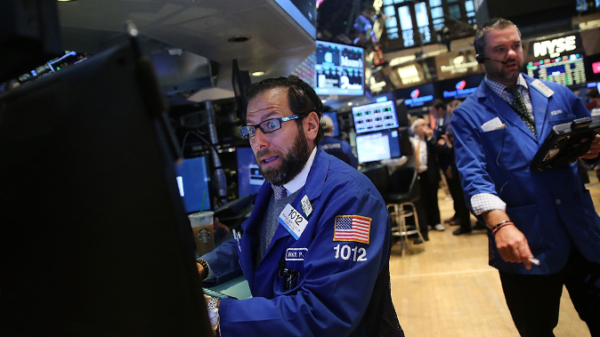 Traders work on the floor of the New York Stock Exchange (NYSE) on August 25, 2015 in New York City. Following a day of steep drops in global markets, the Dow Jones industrial average rallied over 300 points in morning trading. (Spencer Platt/Getty Images)