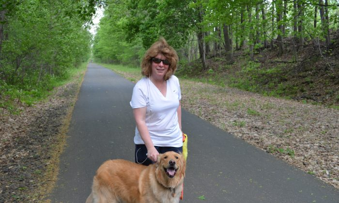 Robin and her Golden Retriever, Ellie, on the Goshen section of the Heritage Trail on May 16, 2015. (Yvonne Marcotte/Epoch Times)