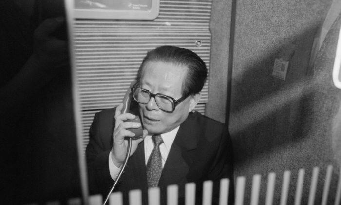 Leader of China, Jiang Zemin, stands in the phone booth of the TGV on his way to visit the nuclear center of Blayais.        (Pierre  Boussel/AFP/Getty Images)