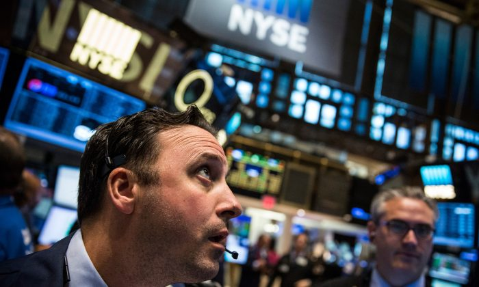 Traders work on the floor of the New York Stock Exchange on Aug. 26, 2015. (Andrew Burton/Getty Images)