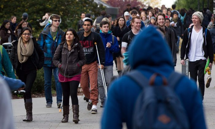 University of British Columbia students walk on campus, Oct. 30, 2013. Food bank use is up on campuses across Canada as tuition fees and living costs rise along with student debt. (The Canadian Press/Darryl Dyck)