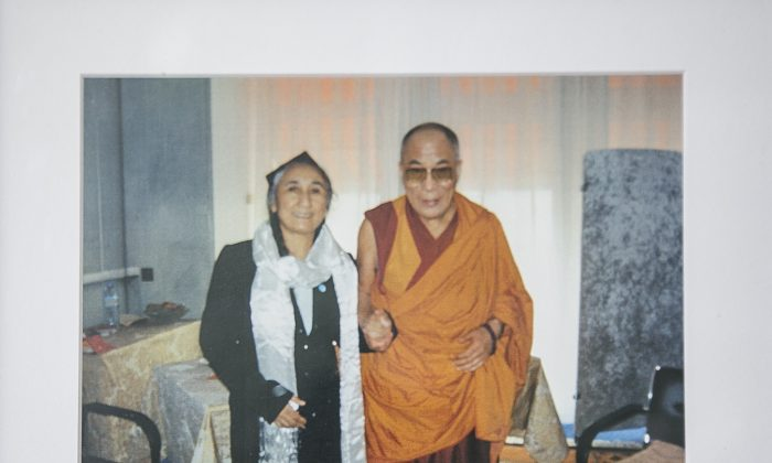Rebiya Kadeer, President of the World Uyghur Congress with His Holiness the Dalai Lama in a photograph at her home. (Samira Bouaou/Epoch Times)