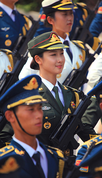 Men Jiahui (C), a 23-year-old Chinese model, marches in a military parade rehearsal in Beijing on Aug, 5, 2015. (Screen shot/Sina)