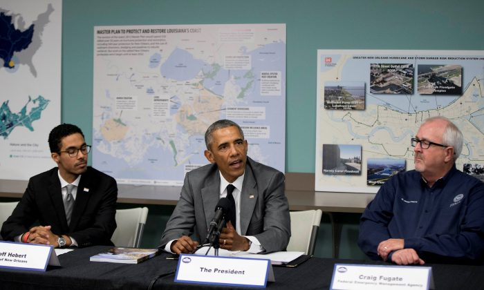 President Barack Obama participates in a roundtable on Hurricane Katrina at the Andrew P. Sanchez Community Center in New Orleans on Thursday, Aug. 27, 2015. (AP Photo/Andrew Harnik)