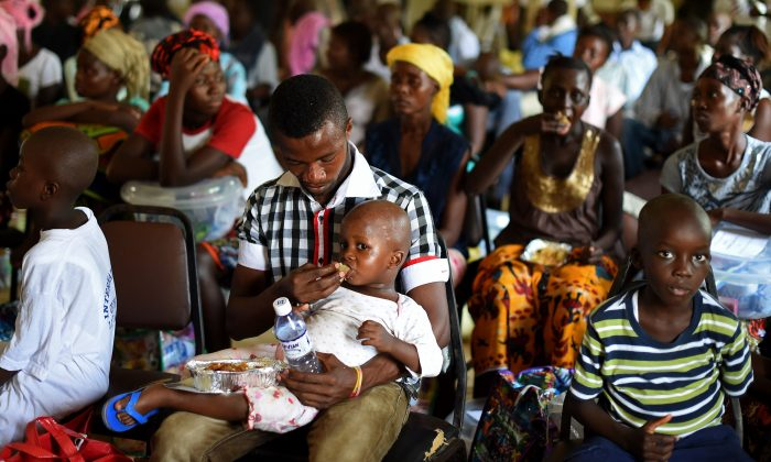 A child who survived the Ebola virus is fed by another survivor at Hastings Treatment Center, on the outskirts of Freetown, Sierra Leone, on Nov. 11, 2014. (Francisco Leong/AFP/Getty Images)