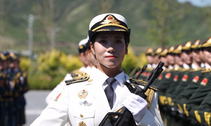 A female soldier from the People's Liberation Army attends a training session for the Sept. 3 military parade to mark the 70th anniversary of China's victory in World War II at a military base in Beijing, China on Aug. 22, 2015. (ChinaFotoPress/Getty Images)