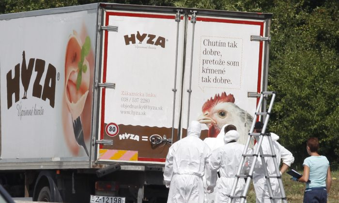 Forensic officers in front of a truck inside which were found a large number of dead migrants on a motorway near Neusiedl am See, Austria, on Thursday, Aug. 27, 2015. (Dieter Nagl/AFP/Getty Images)