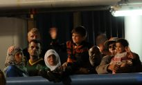 As Asylum-Seekers Flood In, Germany Struggles to House Them