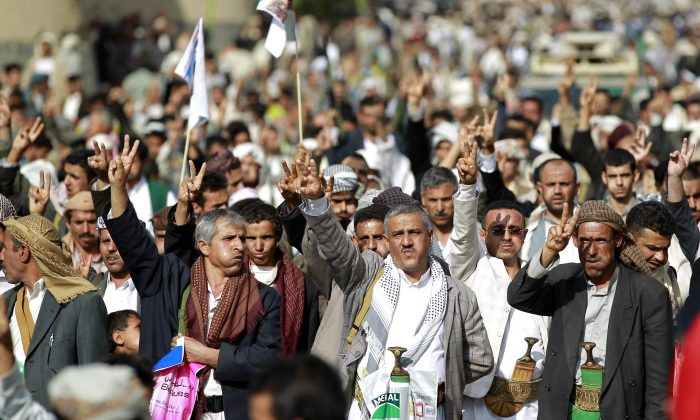 Yemeni supporters of the Shiite Huthi rebel movement, some of them chewing Qat, a mild drug used daily by many Yemenis, raise their weapons during a rally to protest against a military offensive by a Saudi-led coalition, on August 24, 2015 in the capital Sanaa.(Mohammed Huwais /AFP/Getty Images)