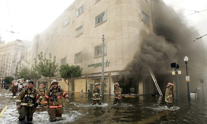 Firefighters arrive at a store on fire on Canal Street August 31, 2005 in New Orleans, Louisiana. Devastation is widespread throughout the city with water approximately 12 feet high in some areas. (Mark Wilson/Getty Images)