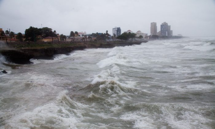 Strong winds and waves batter the coast as Tropical Storm Erika approaches Santo Domingo, in the Dominican Republic, Friday, August 28, 2015. (AP Photo/Tatiana Fernandez)
