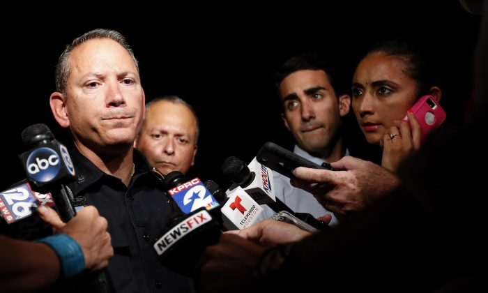 Harris County public information officer Thomas Gilliland speaks to the media after a sheriff's deputy in uniform was fatally shot Friday, Aug. 28, 2015, in Houston. (Karen Warren/Houston Chronicle via AP) MANDATORY CREDIT