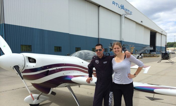 Epoch Times reporter, Holly Kellum (L)  and pilot Andrew Wright on Aug. 27, 2015 in New Windsor, N.Y.. Wright died on Aug. 28 when his plane crashed while practicing for the New York Air Show at Stewart International Airport.(Holly Kellum/Epoch Times)