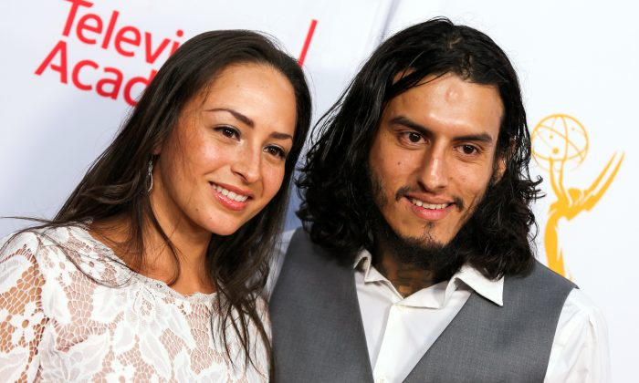 Janiece Sarduy, left, and Richard Cabral arrive at the 2015 Dynamic and Diverse Emmy Celebration at the Montage Hotel on Thursday, Aug. 27, 2015, in Beverly Hills, Calif. (Photo by Rich Fury/Invision/AP)