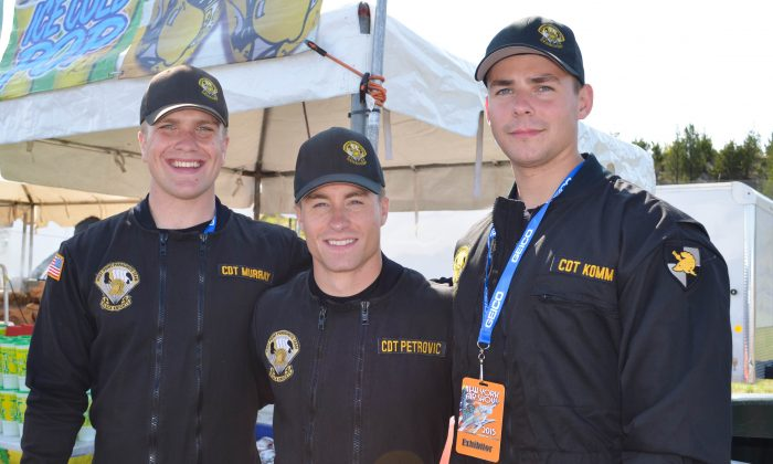 (L-R) Members of the West Point Jump Team Pace Murray, Joshua Petrovik, and Jordan Komm at the New York Airshow at Stewart International Airport on August 29, 2015. (Yvonne Marcotte/Epoch Times)