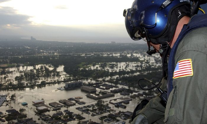 Coast Guard Petty Officer 1st Class Steven Huerta searches for citizens in distress after Hurricane Katrina, in New Orleans, Louisiana, on Aug. 29, 2005. (Kyle Niemi/U.S. Coast Guard via Getty Images)