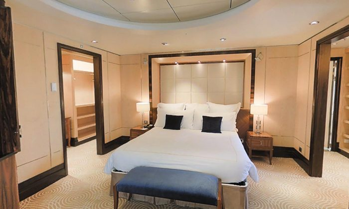 This image made using a 3-D camera from Matterport shows the bedroom of the 2,249 square foot Grand Duplex suite aboard Cunard's Queen Mary 2, in New York. (AP Photo)