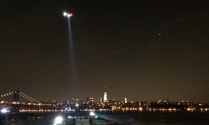 A helicopter searches for the body of a woman who jumped into the East River during the early hours of Aug.  30, 2015. (Courtesy of Seth Hirsch)