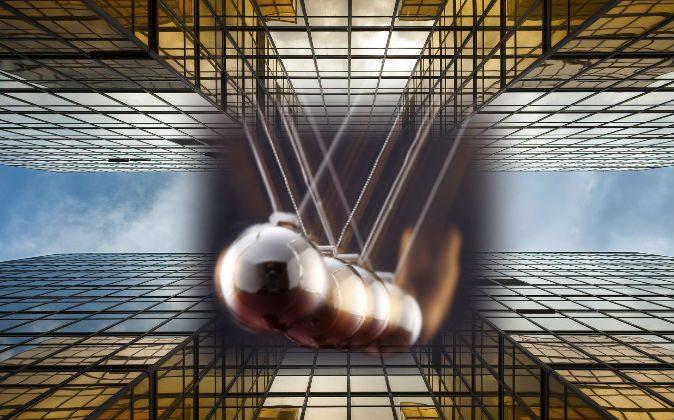 Newton's Pendulum (Eskaylim/iStock) Buildings (LeeYiuTung/iStock)