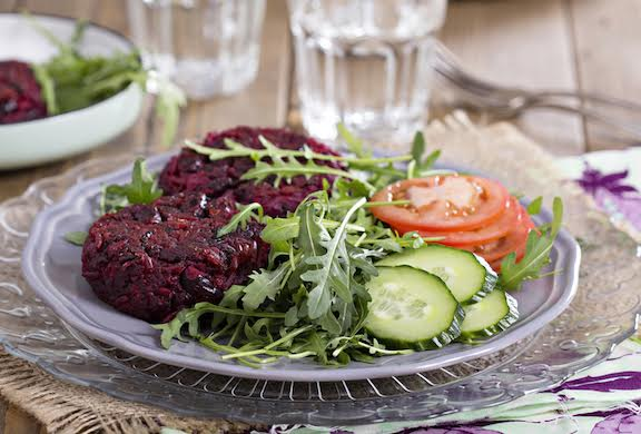 Vegan burgers with beetroot and beans served with fresh vegetables (eluxemagazine.com)