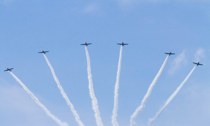 The Geico Skytypers flying in formation with smoke trailing behind them at the New York Air Show on Aug. 30, 2015 at Stewart International Airport in New Windsor. (Holly Kellum/Epoch Times)