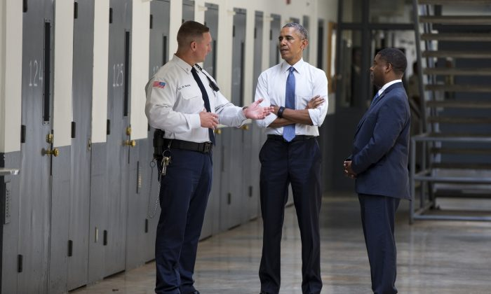 President Barack Obama is led on a tour by Bureau of Prisons Director Charles Samuels (R) and Correctional Officer Ronald Warlick (L) during a visit to the El Reno Federal Correctional Institution, in El Reno, Okla., on July 16, 2015. (Evan Vucci/AP)