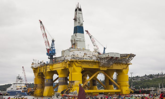 ShellNo flotilla participants float near the Polar Pioneer oil drilling rig during demonstrations against Royal Dutch Shell  in Seattle on May 16, 2015. (David Ryder/Getty Images)