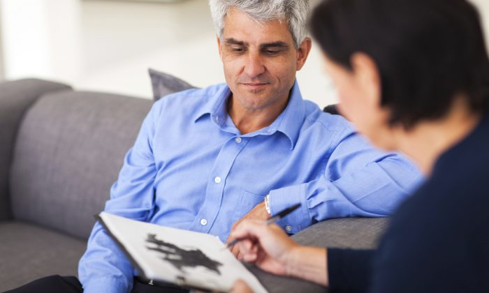 depressed middle aged man in session with therapist(Michael Jung/iStock)