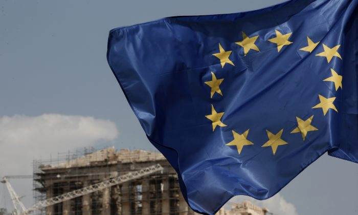 A European Union (EU) flag flutters in front of the temple of the Parthenon in Athens, Greece, on Aug. 15, 2015. (Yorgos Karahalis/AP)