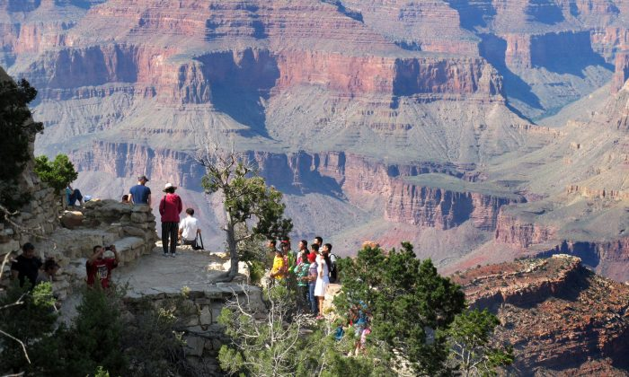 Visitors gather at an outlook on the South Rim of Grand Canyon National Park in northern Arizona, on Aug. 19, 2015. (Felicia Fonseca/AP Photo)