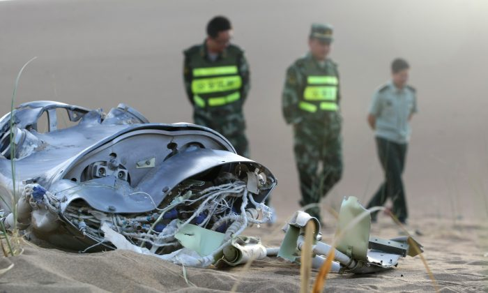 Remains from a Chinese space launch are left in the Badain Jaran Desert on June 12, 2013, in Alxa League, Inner Mongolia Autonomous Region of China. The Chinese regime is making a push to defense space-based weapons. (ChinaFotoPress/Getty Images)