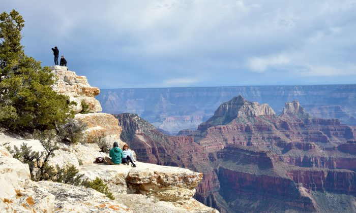 Tourists take photos from the North Rim of the Grand Canyon on May 18, 2015. (Mladen Antonov/AFP/Getty Images)