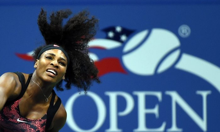 Serena Williams of the US serves to Vitalia Diatchenko of Russia during their Womens Singles Round 1 match at the 2015 US Open at USTA Billie Jean King National Tennis Center in New York on August 31, 2015. (Jewel Samad/AFP/Getty Images)