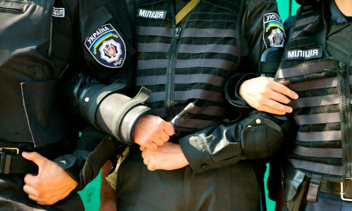 Police in riot gear brace to hold back protesters. (Nolan Peterson/The Daily Signal)