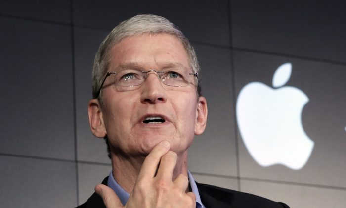 Apple CEO Tim Cook  during a news conference at IBM Watson headquarters in New York on April 30, 2015. (AP Photo/Richard Drew)