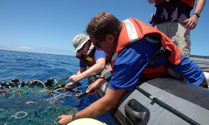 Workers with the Scripps Institution of Oceanography collect sea garbage in the Pacific Ocean. Discarded plastics often end up in the ocean, creating coastal pollution that harms marine life and gathers out at sea in what's become known as the Great Pacific Garbage Patch. (AP Photo/ Scripps Institution of Oceanography, Mario Aguilera, File)