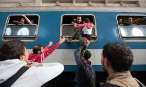Hungary Opens Door to Trains for Migrants, but Only to Camps