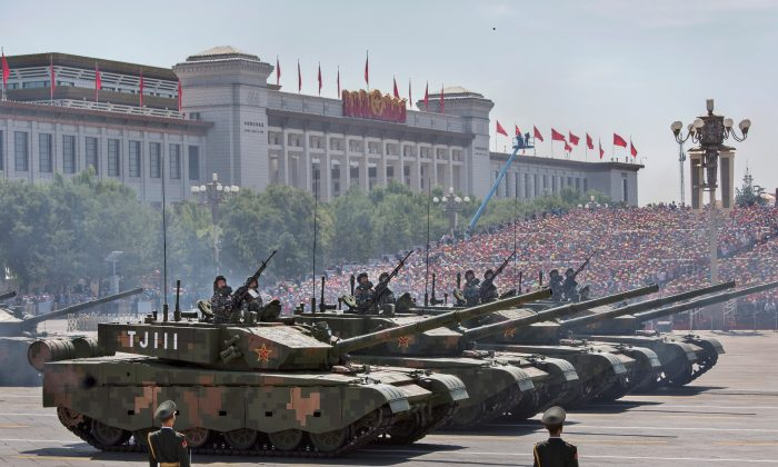 Chinese soldiers ride in tanks as they pass in front of Tiananmen Square during a military parade to mark the 70th year since the Allied victory in World War II in Beijing on Sept. 3, 2015. (Kevin Frayer/Getty Images)