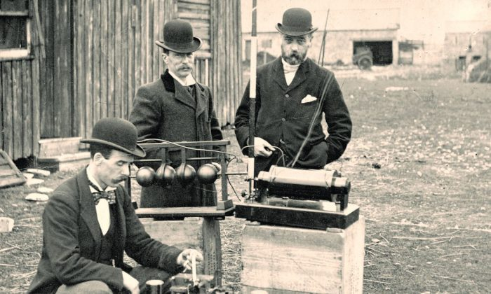British Post Office engineers inspect Guglielmo Marconi's wireless telegraphy (radio) equipment, during a demonstration on Flat Holm island, 13 May 1897. This was the world's first demonstration of the transmission of radio signals over open sea, between Lavernock Point and Flat Holm Island, a distance of 3 miles. (Council Flat Holm Project/Wikimedia Commons, CC BY