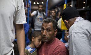 Merkel Demands EU Partners Share Burden of Migrant Influx