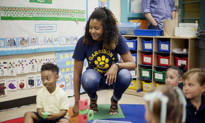 Pre-K teacher Epernay Kyles meets with her students on the first day of class on Aug. 28. (AP Photo/Pablo Martinez Monsivais)