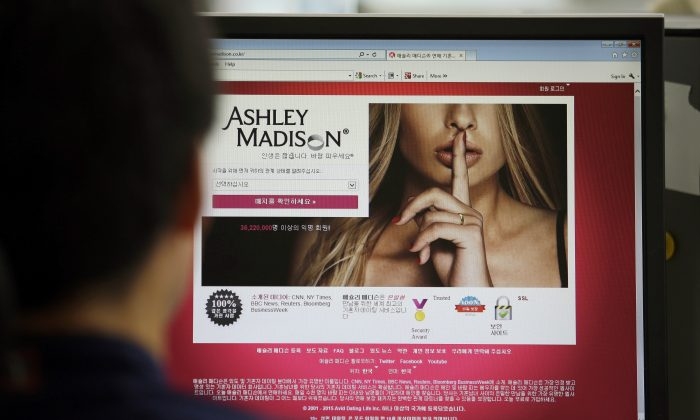 Ashley Madison's Korean web site on a computer screen in Seoul, South Korea on June 10, 2015. (AP Photo/Lee Jin-man)