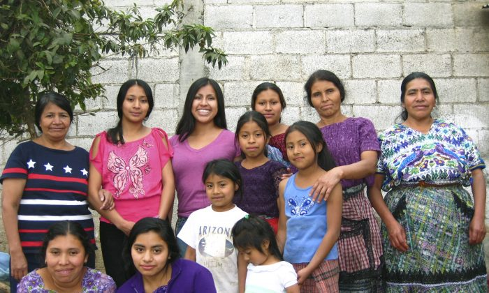 Gemma Givens- background third from left- with relatives in Santiago, Sacatepequez, Guatemala in March 24, 2012. (Courtesy of Gemma Givens via AP)