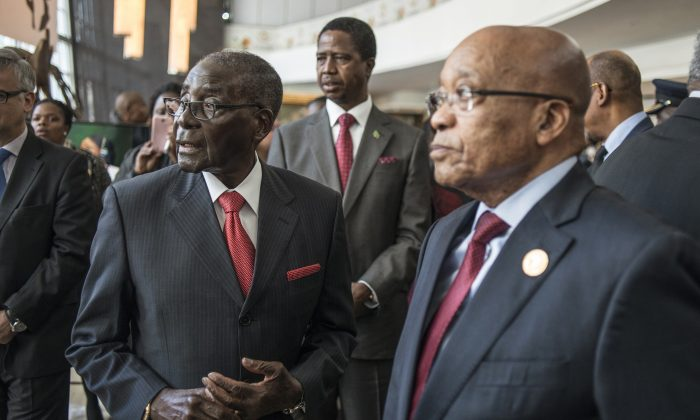 Zimbabwean President and Chairperson of the African Union Robert Mugabe (L), Zambian President Edward Lungu (C), and South African president Jacob Zuma (R) arrive for the 25th African Union Summit in Sandton, Johannesburg, South Africa, on June 13, 2015. (Mujahid Safodien/AFP/Getty Images)