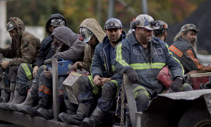 In this Oct. 15, 2014 photo, coal miners return on a buggy after working a shift underground at the Perkins Branch Coal Mine in Cumberland, Ky. As recently as the late 1970s, there were more than 350 mines operating at any given time in Harlan County. In 2014, it's around 40. (AP Photo/David Goldman, File)