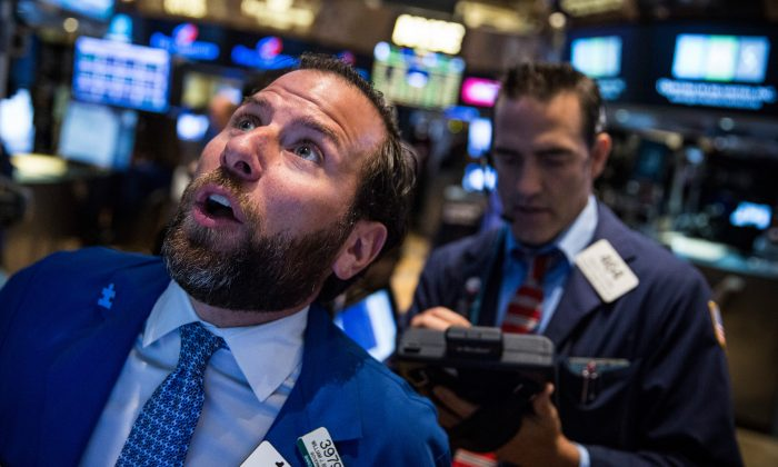 Traders work on the floor of the New York Stock Exchange during the morning of August 27, 2015 in New York City. (Andrew Burton/Getty Images)