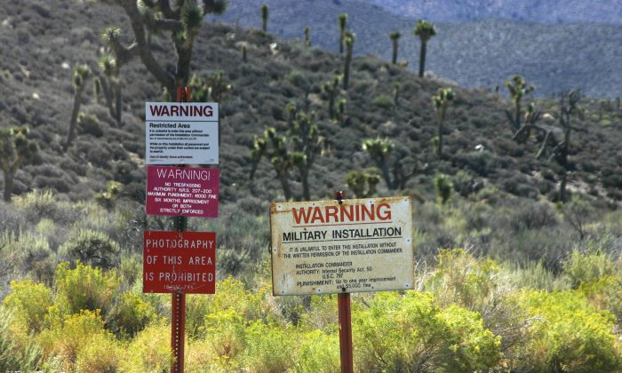 The warning signs on the road leading into Groom Lake, aka Area 51. (LPETTET/iStock)