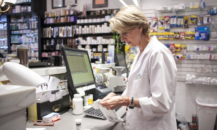 A pharmacist at the Northside Pharmacy in Brooklyn, New York, June 18, 2014. (Samira Bouaou/Epoch Times)