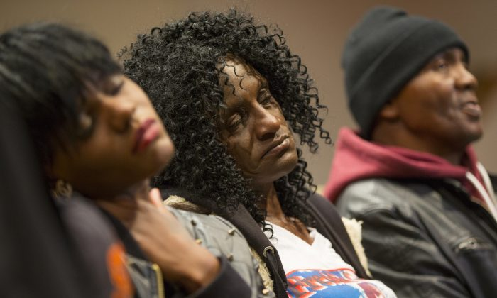 Family members of Freddie Gray, sister Fredricka Gray, left, mother Gloria Darden, center, and stepfather Richard Shipley listen during a news conference after a day of unrest following the funeral of Freddie Gray on Monday, April 27, 2015, in Baltimore. (AP Photo/Evan Vucci)