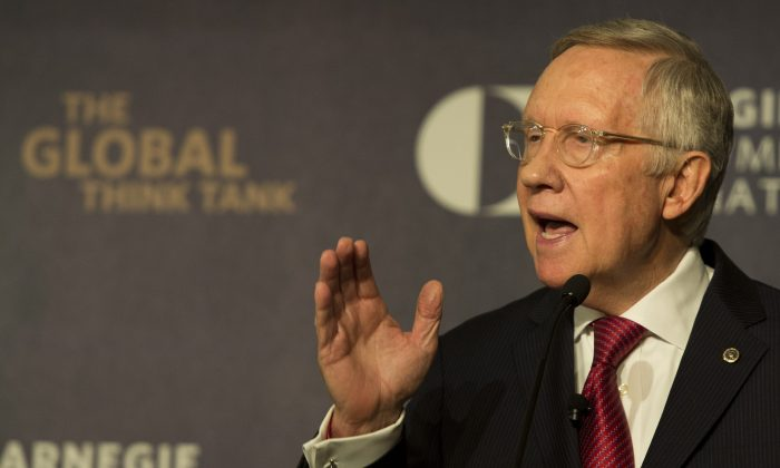 Senate Minority Leader Harry Reid (D-NV) gestures as he speaks about the Iran nuclear deal at the Carnegie Endowment for International Peace in Washington, DC on September 8, 2015. (Andrew Caballero-Reynolds/AFP/Getty Images)